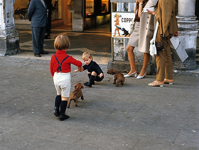 October 9th-11th, 1970 /  Venice trip:  Piazza San Marco.  A rare moment captured with my camera, where the child and the dog mimic the Coppertone sign.