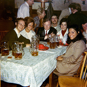 """September 24th-27th, 1970 / Oktoberfest Trip:  At our 2nd German watering hole away from Oktoberfest. L to R:  Tim Redman, Wolfgang's wife, Wolfgang, my happy self, Anita Quish, Carol Landini,  and a very tired/bored looking friend of Wolfgang's.  If 5 1/2 liters of strong German beer wasn't enough, our German friends prevailed upon me to finish the evening with a few shots of mint-flavored schnapps. I guess we had a real """"local"""" experience thanks to them, and we """"cured"""" our hangovers the next day with a salty, porcine German lunch."""