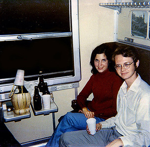September 24th-27th, 1970 / Oktoberfest Trip:  My friends Anita Quish and Tim Redman enjoy Italian beer and wine on the night train to Munich. Most of the student body––some 374 strong––was there for this party on wheels.