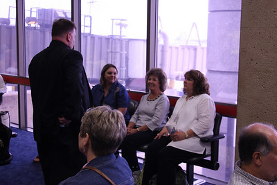 Waiting to leave DFW.  Fr. White talking with Karen Bishop, Patty Livingston, and Cynthia Tynes. Sandi Rhoades' head graces the foreground of the photo.