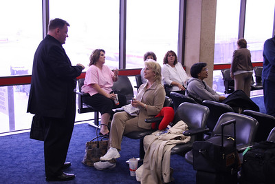 Fr. White and Katie Neilsen.  Her mother Karen Iverson is on the right looking out the window. Girl in pink is Melinda Leslie, the head next to her belongs to Patty Livingston, Melinda's mother, and girl in white is Cynthia Tynes.  Brigit Harootunian is behind Katie.