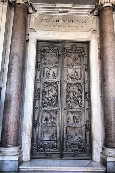 One of the 12 foot high cast doors to Santa Maria Maggiore Church, north entrance