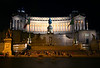"Victor Emmanuel Monument, a massive marble structure erected in honor of the Italian leader who was the first Italian king when the diverse provinces of the region were united into the country of Italy in the mid 1800's. It has been sacastically tagged as the ""Wedding Cake"" by skeptics who were upset at its cost, size, lavish use of superb marble, and the fact that it covers (rather permanently) a big section of ancient Rome not well explored archeologically."