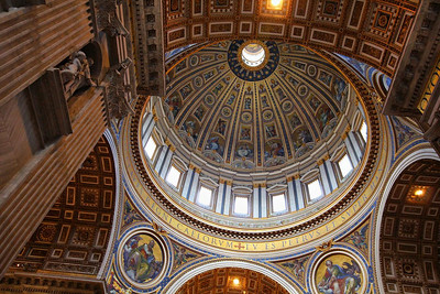 The arena-sized scale of this wondrous hall is hard to grasp. Click on the original size photo and notice the pencil-thin black lines on the left parapet and inside the dome below the huge windows. These are full size handrails. The blue letters around the base of the dome are 7 feet high, according to our special Vatican tour director. Moving several steps barely changes the perspective angle of the top of the dome.