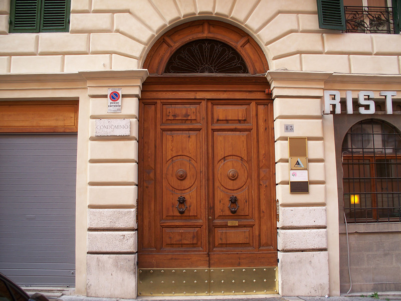 43 Via Firenze in the neighborhood of Monti -- where we stayed.  Heavy doors had actuators to open and close the doors.