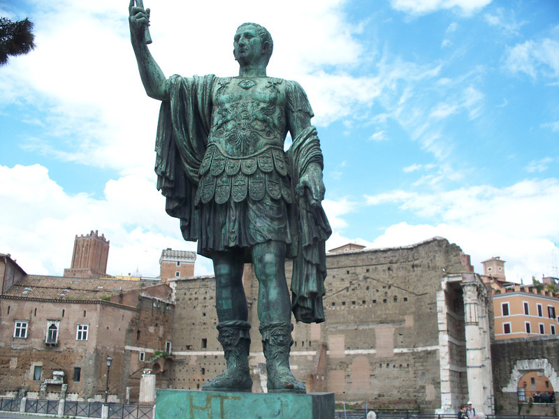 statue 1 of 3 in front of Foro Traiano