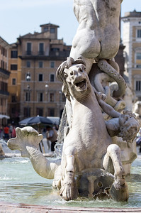 The Fountain of Neptune  (Fontana del Nettuno) is one of the most famous fountains in Rome, and is located on the Piazza Navona. There is another fountain with the same name, in the Piazza del Popolo! First built with only a basin (which lasted for hundreds of years), the fountain was finished in 1878, by two sculptors, Antonio delle Bitta and Gregorio Zappala. The main sculpture shows Neptune battling an octopus, and other sculptures that fit the ancient mythological theme of Nereids, cupids, and walruses.