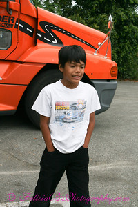 Phillip in front of The Mr. Carter's truck.