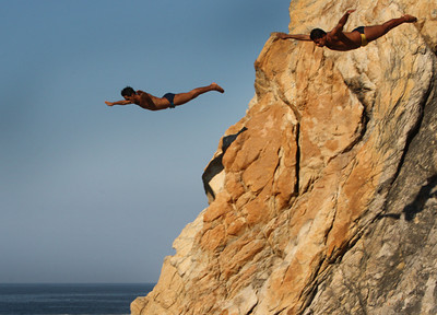 pair of divers jump