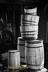 A pile of hand crafted barrels and buckets at the cooper's shop. Ross Farm Museum, Nova Scotia.