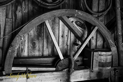A wheel on the wall of the cooper's shed. Ross Farm Museum, Nova Scotia.