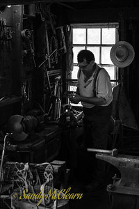 Blacksmith at work. Ross Farm Museum, Nova Scotia.