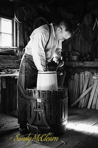 A cooper (barrel maker) plies his trade. Ross Farm Museum, Nova Scotia.