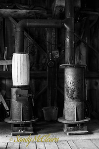 A barrel in midst of the the crafting process sits on a wood stove. Ross Farm Museum, Nova Scotia.