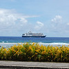 My ship, the M/S Rotterdam at anchor a mile offshore of Rarotonga with two tenders alongside, forward and aft.