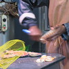 Preparing more scallops at open market at Place du Vieux Marche, Rouen.