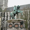 Statue of Napoleon in front of the Hotel de Ville (City Hall) in Rouen. Church of Saint Ouen  next to the Hotel de Ville in the photo.