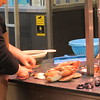 Preparing scallops at open market at Place du Vieux Marche, Rouen.