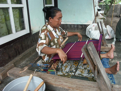 A backstrap loom in use