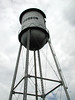 """MY KIND OF """"WATER"""" TOWER<br /> Bourbon, Missouri<br /> <br /> If you ever find yourself in need of a little libation, I'm sure the fine folks of this town will fix you right up. Now that's the giant economy size right there!"""