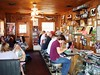 "THE ROCK CAFE -- INTERIOR SHOT<br /> Stroud, Oklahoma<br /> <br /> Is this a great place, or what? If you look closely at the wall on the right, you can make out the pass-through to the kitchen and the owner/cook, Sally. Her terse remarks to her ""staff"" (her kids) was, ""Tell those people out there there's no 'medium rare' or 'well done.' The food's just cooked and that's that!"" Actually, her kids didn't have to tell us at all, as everyone in the joint could hear her. Quite the place, let me tell you."