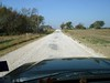 ABANDONED ROUTE 66 SECTION<br /> Somewhere in the middle of nowhere, Oklahoma<br /> <br /> In my dogged determination to follow as much of the original Route 66 roadway as I could find, I was led to this returning-to-dirt-road portion of it out in the sticks of Oklahoma. At this point, I was getting the feeling I was about to be lost, so I stopped for a while to consider continuing on. As soon as my feet touched the dirt road, I was overcome with a flood of memories and immediately felt right at home, recalling my own dirt road days back in my Grandparents' tiny little home town of Lometa, Texas. Funny how that works sometimes. Needless to say, I did continue on.
