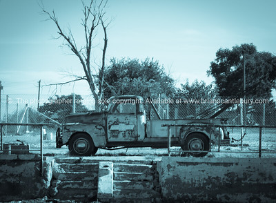 Old Chev tow truck, parked and left to rust away, filter old image effect