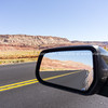 In the rear view mirror, the raod ahead and behind, desert scenery around on Route 66 roadtrip.