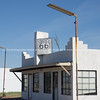 White roadside building with Route 66 sign, Shamrock, Texas.