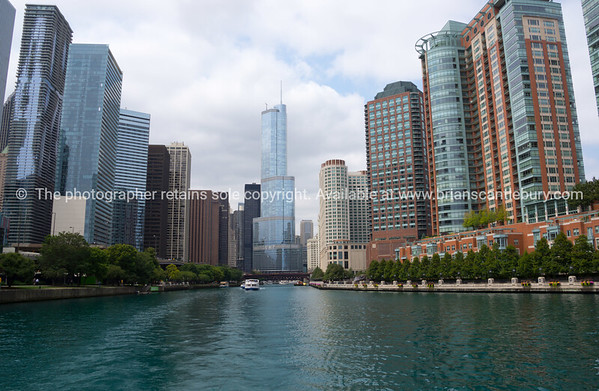 Chicago River flowing between city high-rise to Lake Michigan.