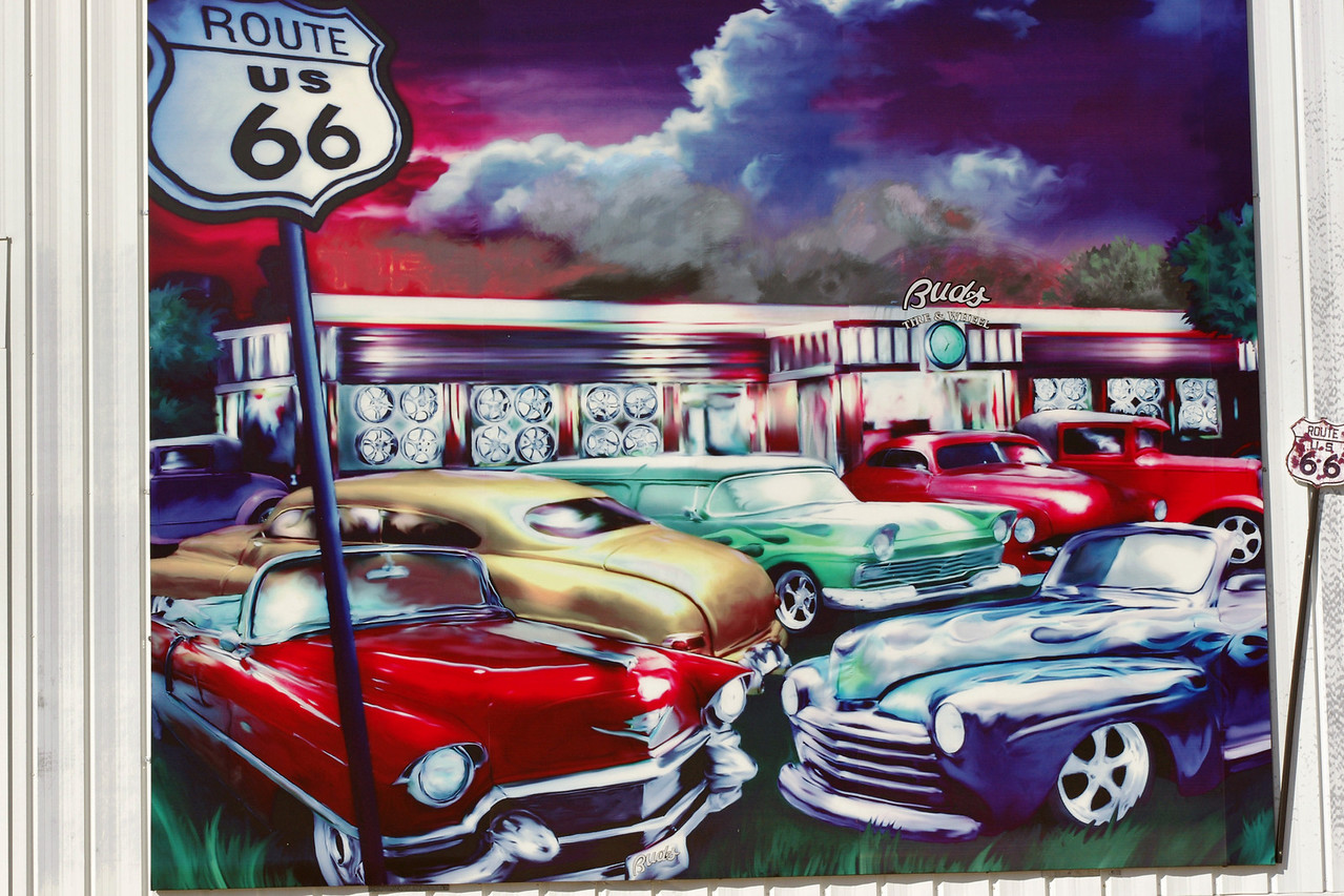 Car mural painted on the wall of Bud's Tire and Wheel on old Route 66 (College Street), just west of the square, Springfield, Missouri.