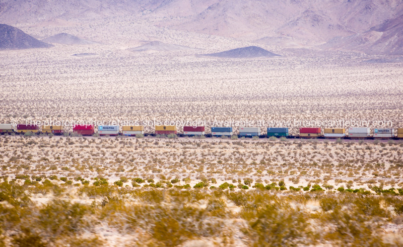 Mile long train though Mojave Desert, Ludlow, California, USA.