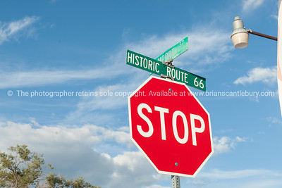 Historic Route 66 sign above stop.