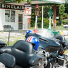 Historic gas station Sinclair, Missouri with motorcycles and patriotic helmets