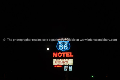 Historic Route 66 Motel sign on black background in Seligman, Arizona, USA.