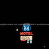 Historic Route 66 Motel sign on black background in Seligman, Arizona, USA.