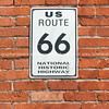 US Route 66 National Historic Highway sign on red brick wall, Galena, Kansas, USA