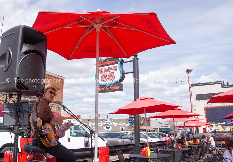 Country and Western signer in outdoor cafe, Williams, Arizona, USA