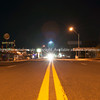 Double yellow lines stretch into darkness on Route 66 through Seligman Arizona, USA
