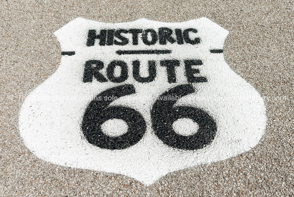 Historic Route 66 sign on forecourt of Texaco garage restored at Dwight, Illinois, USA.dng