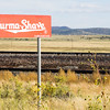 Burma Shave, historic American brand  famous for its advertising gimmick of posting humorous rhyming poems on small sequential highway roadside signs, along Route 66.