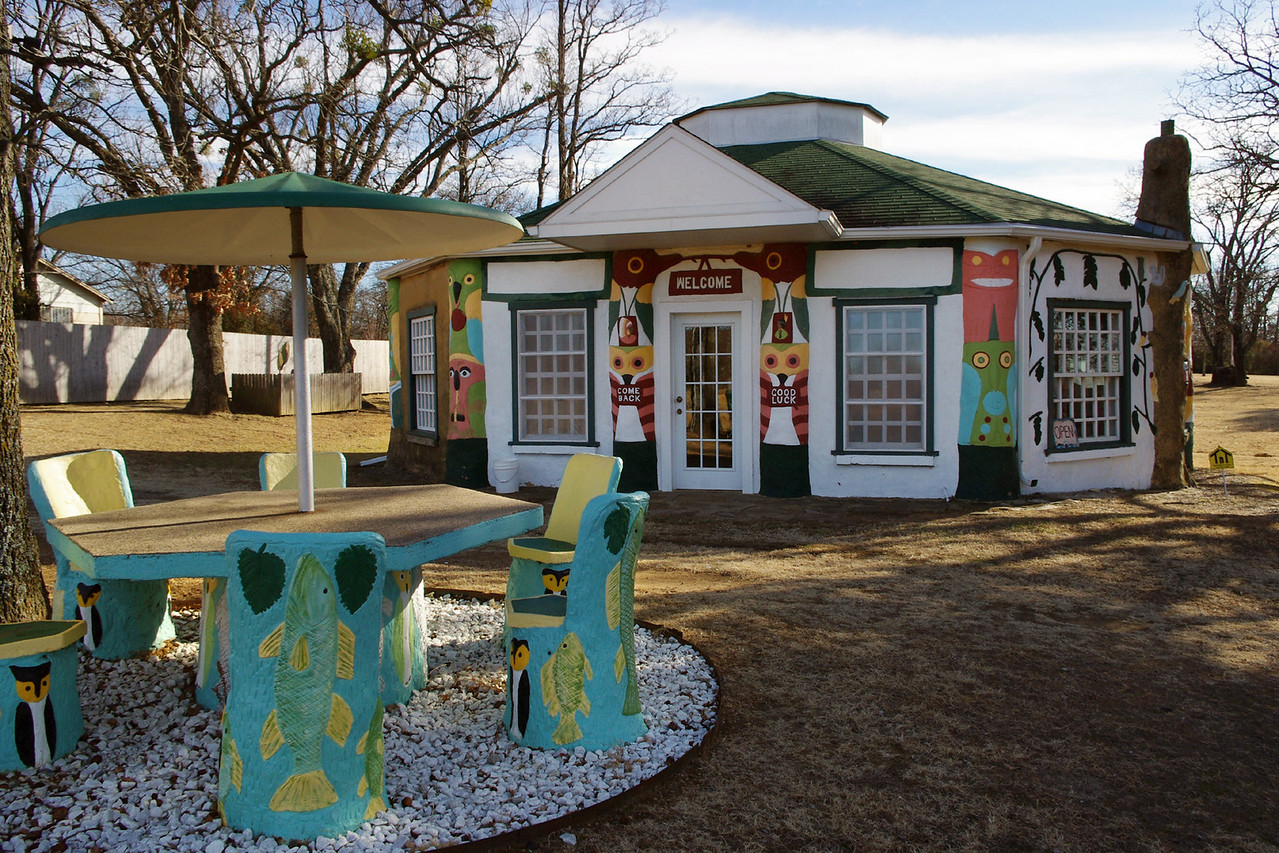 Visitor Center & Gift Shop, Totem Pole Park near Foyil, Oklahoma. <br /> <br /> The artist's first love was wood, and  the gift shop exhibits dozens (hundreds?) of violins made by Ed Galloway from different kinds of wood.