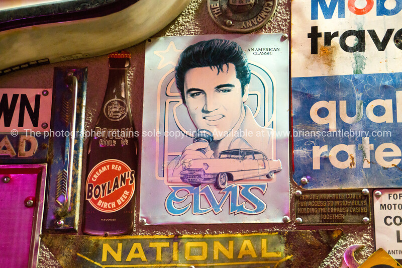 Old signs and famous brands and Elvis at 50's style Diner on Historic Route 66, Albuquerque, New Mexico, USA.