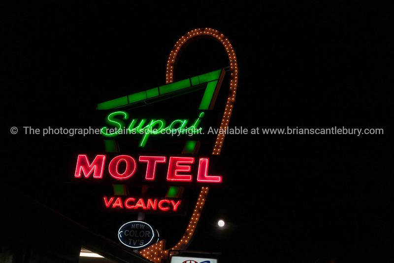 Famous Supai Motel neon signs on black background, Seligman, Arizona, USA