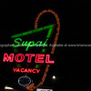 Famous Supai Motel neon signs on black background, Seligman, Arizona, USA