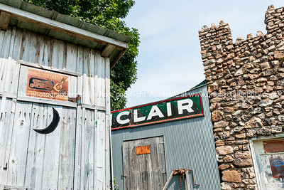 Old buildings, stone and wooden,at Sinclair gas station on Route 66, Missouri, USA.