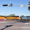 Mile long train two engines crosses street in Gallup, New Mexico beside Historic Route 66.