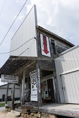 Whitehall Mercantile, old building in long deteriorating state selling junk, collectables and antiques on Route 66, Halltown, MO.
