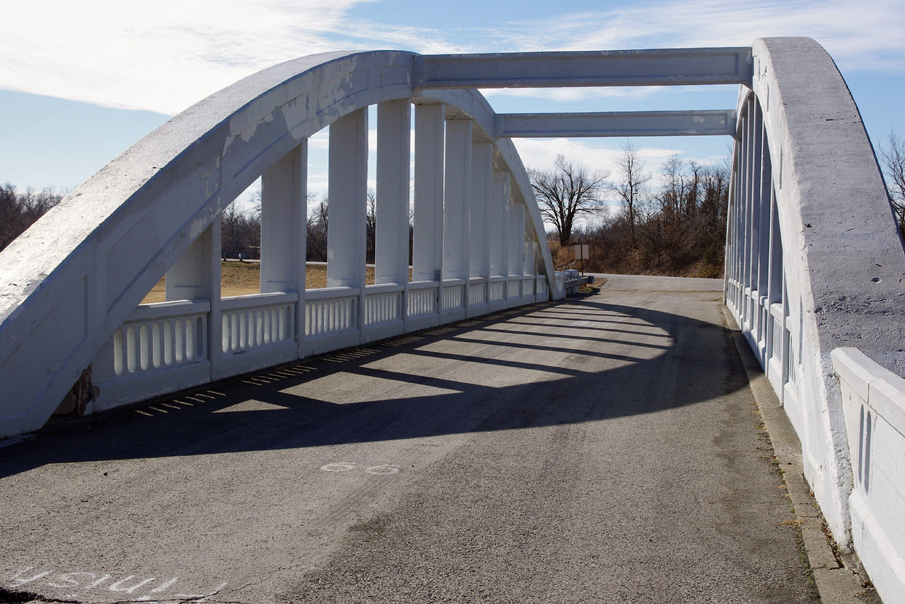 Concrete rainbow Arch Bridge over Brush Creek, west of Riverton, Kansas.