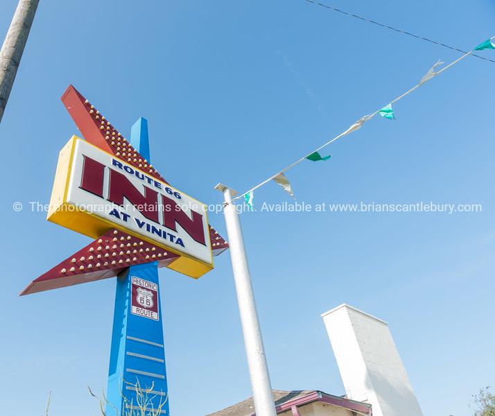 Retro neon arrow shape sign on Route 66, Inn at Vinita, Oklahoma, USA